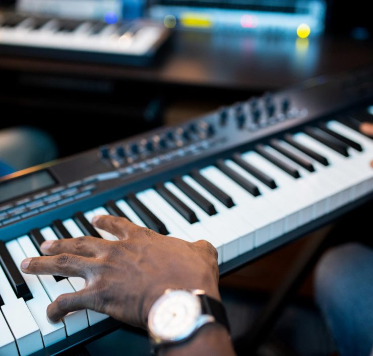 hands-of-young-african-composers-or-musician-touch-YJN5GHX.jpg