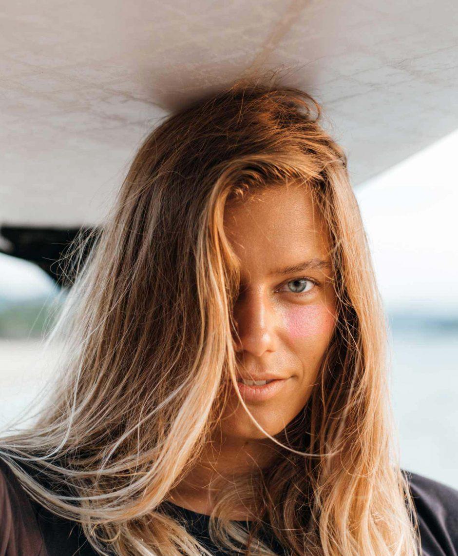 surfer-girl-on-beach-RF74LBQ-1.jpg